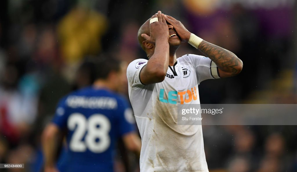 Swansea player Andre Ayew reacts after a chance goes begging during the Premier League match between Swansea City and Chelsea at Liberty Stadium on April 28, 2018 in Swansea, Wales.