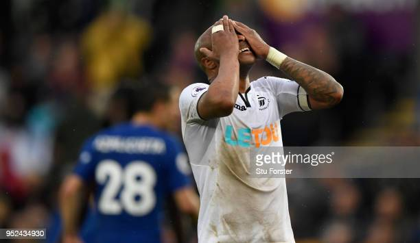 Swansea player Andre Ayew reacts after a chance goes begging during the Premier League match between Swansea City and Chelsea at Liberty Stadium on...