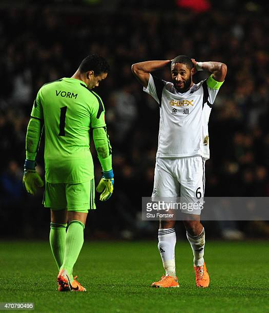 Swansea player Ashley Williams and keeper Michel Vorm react during the UEFA Europa League Round of 32 first leg between Swansea City and SSC Napoli...