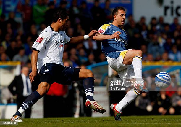 Swansea player Ashley Williams and Michael Chopra of Cardiff challenge for the ball during the Coca Cola Championship match between Cardiff City and...