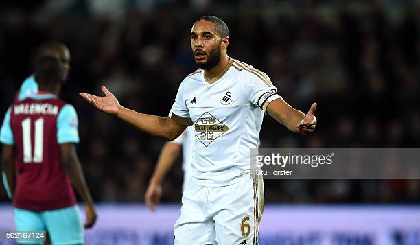 Swansea player Ashley Williams appeals to the linesman after a penalty appeal is turned down during the Barclays Premier League match between Swansea...