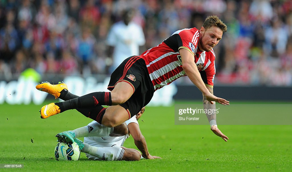 Swansea player Ashley Williams (r) challenges Connor Wickham of Sunderland during the Barclays Premier League match between Sunderland and Swansea City at Stadium of Light on September 27, 2014 in Sunderland, England.