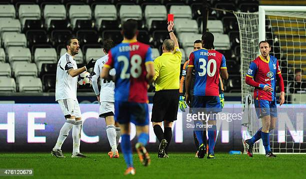 Swansea player Chico Flores is sent off by referee Mike Dean during the Barclays Premier League match between Swansea City and Crystal Palace at...