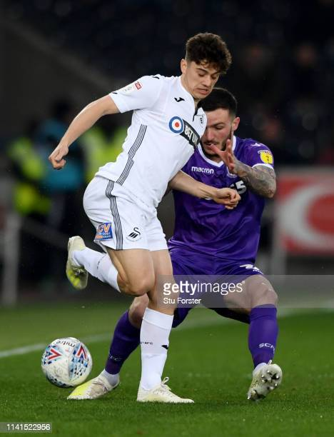 Swansea player Daniel James is challenged by Tom Edwards of Stoke during the Sky Bet Championship match between Swansea City and Stoke City at...