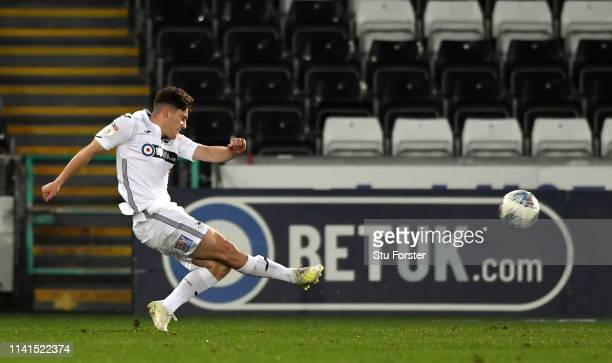 Swansea player Daniel James shoots to score the opening goal during the Sky Bet Championship match between Swansea City and Stoke City at Liberty...