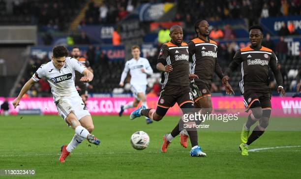 Swansea player Daniel James shoots to score the second Swansea goal after running hlaf the length of the pitch during the FA Cup Fifth Round match...