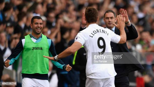 Swansea player Fernando Llorente celebrates his and the winning goal with Jordi Amat and head coach Paul Clement during the Premier League match...