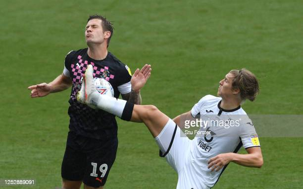 Swansea player George Byers challenges James Collins of Luton during the Sky Bet Championship match between Swansea City and Luton Town at Liberty...