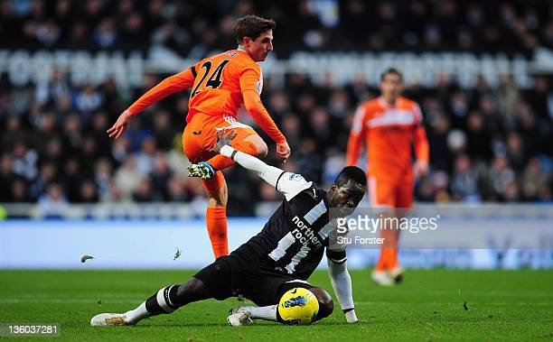 Swansea player Joe Allen is challenged by Cheick Tiote during the Barclays Premier league game between Newcastle United and Swansea City at St James'...