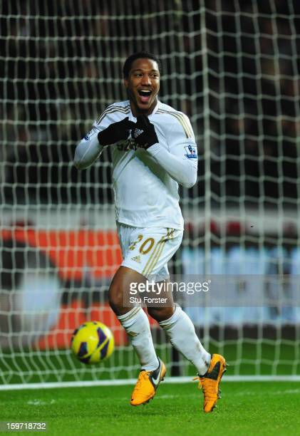 Swansea player Jonathan de Guzman celebrates after his second goal made it 3-0 during the Barclays Premier League match between Swansea City and...