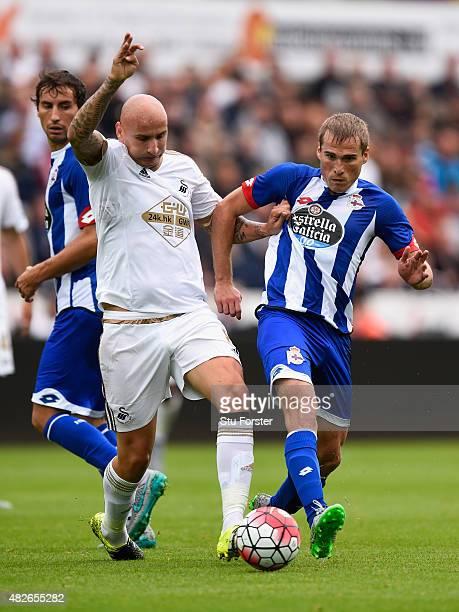 Swansea player Jonjo Shelvey challenges Alex Bergantinos of Deportiva during the Pre season friendly match between Swansea City and Deportivo La...