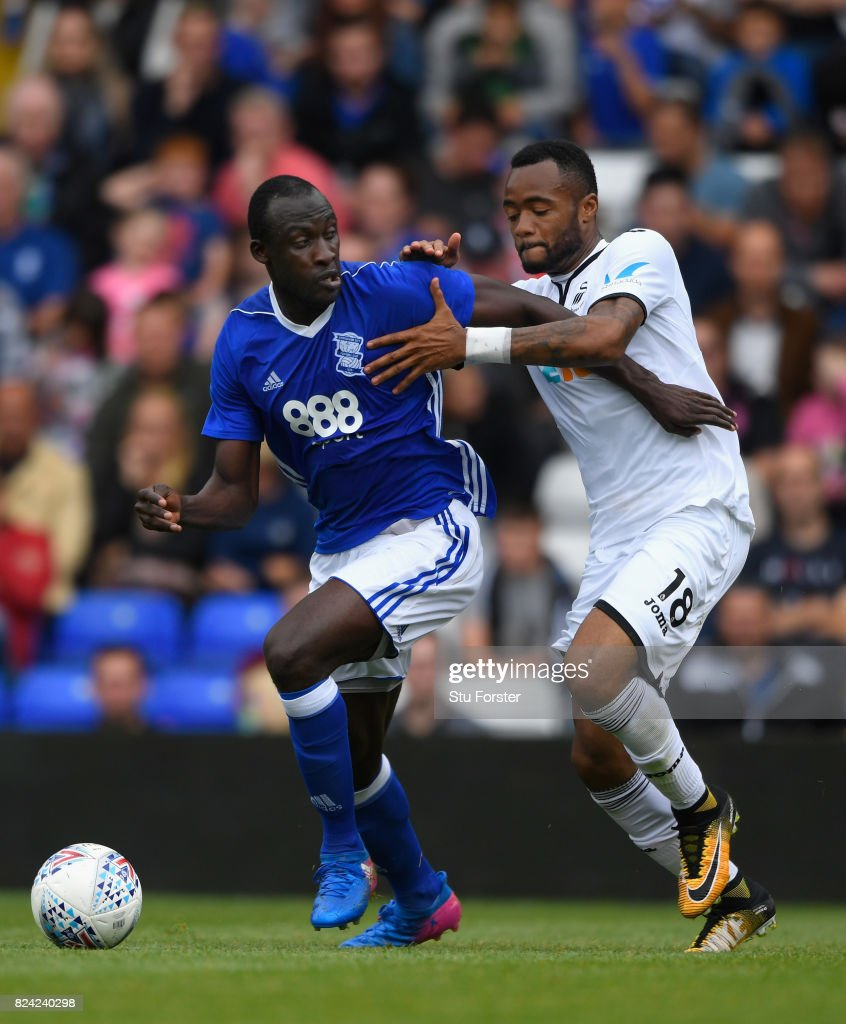 Swansea player Jordan Ayew (r) challenges Cheikh Ndoye of Birmingham during the Pre Season Friendly match between Birmingham City and Swansea City at St Andrews (stadium) on July 29, 2017 in Birmingham, England.