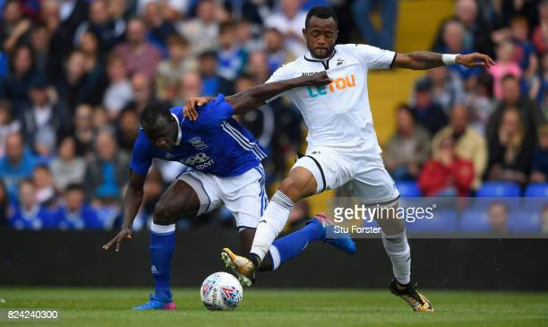 Swansea player Jordan Ayew challenges Cheikh Ndoye of Birmingham during the Pre Season Friendly match between Birmingham City and Swansea City at St...