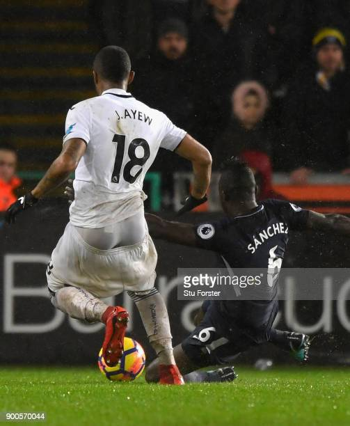 Swansea player Jordan Ayew chases down Davinson Sanchez with his shorts coming down during the Premier League match between Swansea City and...