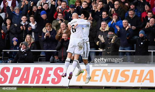 Swansea player Ki Sung Yueng celebrates with Jonjo Shelvey after scoring the first Swansea goal during the Barclays Premier League match between...