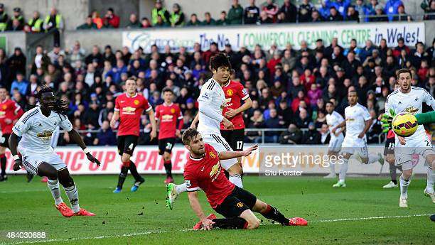 Swansea player Ki Sung Yueng scores the first Swansea goal during the Barclays Premier League match between Swansea City and Manchester United at...