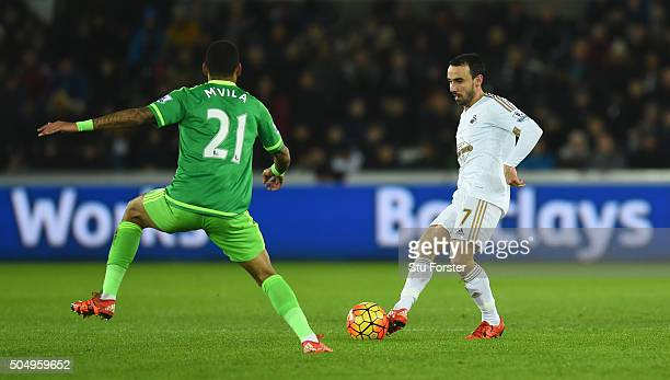 Swansea player Leon Britton in action during the Barclays Premier League match between Swansea City and Sunderland at Liberty Stadium on January 13...
