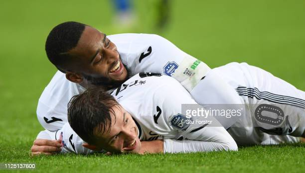 Swansea player Leroy Fer congratulates goalscorer Bersant Celina after the 3rd Swansea goal during the FA Cup Fourth Round match between Swansea City...