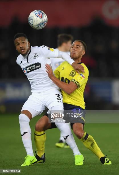 Swansea player Martin Olsson is challenged by Elliott Bennett of Blackburn during the Sky bet Championship EFL match between Swansea City v Blackburn...