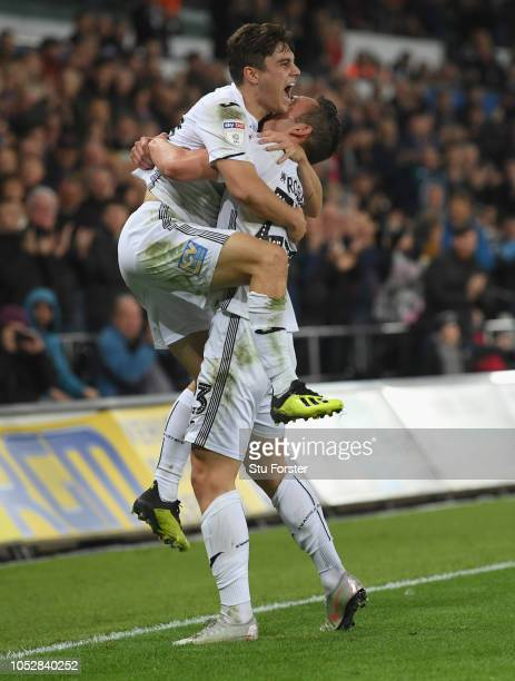 Swansea player Martin Roberts celebrates with Dan James after scoring the second Swansea goal during the Sky bet Championship EFL match between...