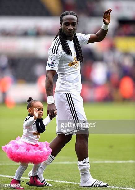 Swansea player Marvin Emnes and child wave to the crowd on the teams lap of the pitch after the Barclays Premier League match between Swansea City...