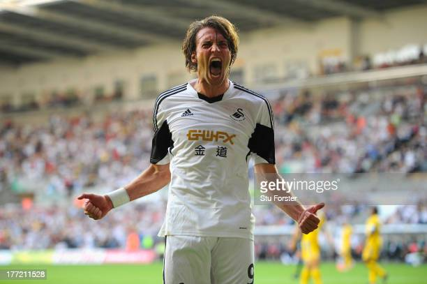 Swansea player Michu celebrates after scoring the second swansea goal during the UEFA Europa League play-off first leg between Swansea City and FC...