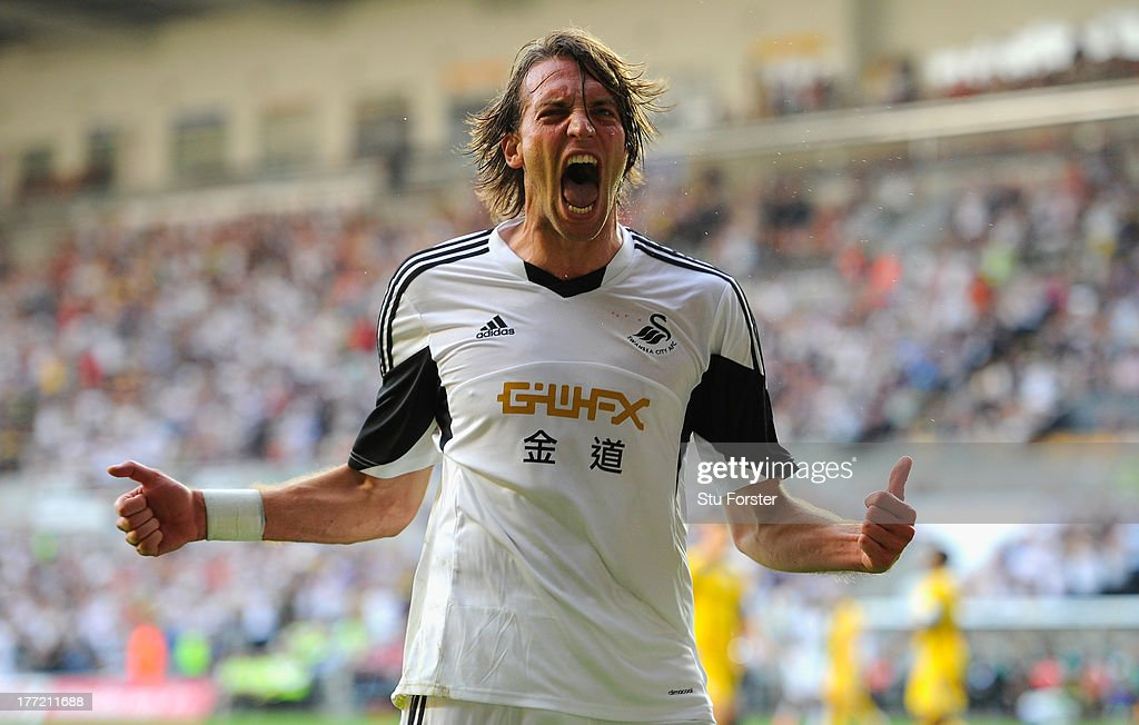 Swansea player Michu celebrates after scoring the second swansea goal during the UEFA Europa League play-off first leg between Swansea City and FC Petrolul Ploiesti at Liberty Stadium on August 22, 2013 in Swansea, Wales.