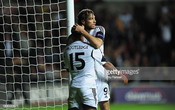Swansea player Michu celebrates with goalscorer Wayne Routledge after the first Swansea goal during the UEFA Europa League match between Swansea City...