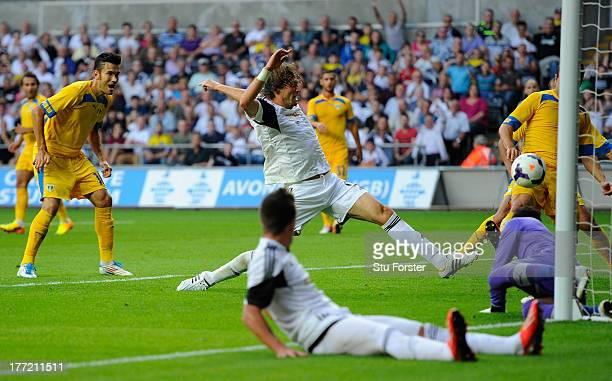 Swansea player Michu scores the second swansea goal during the UEFA Europa League play-off first leg between Swansea City and FC Petrolul Ploiesti at...