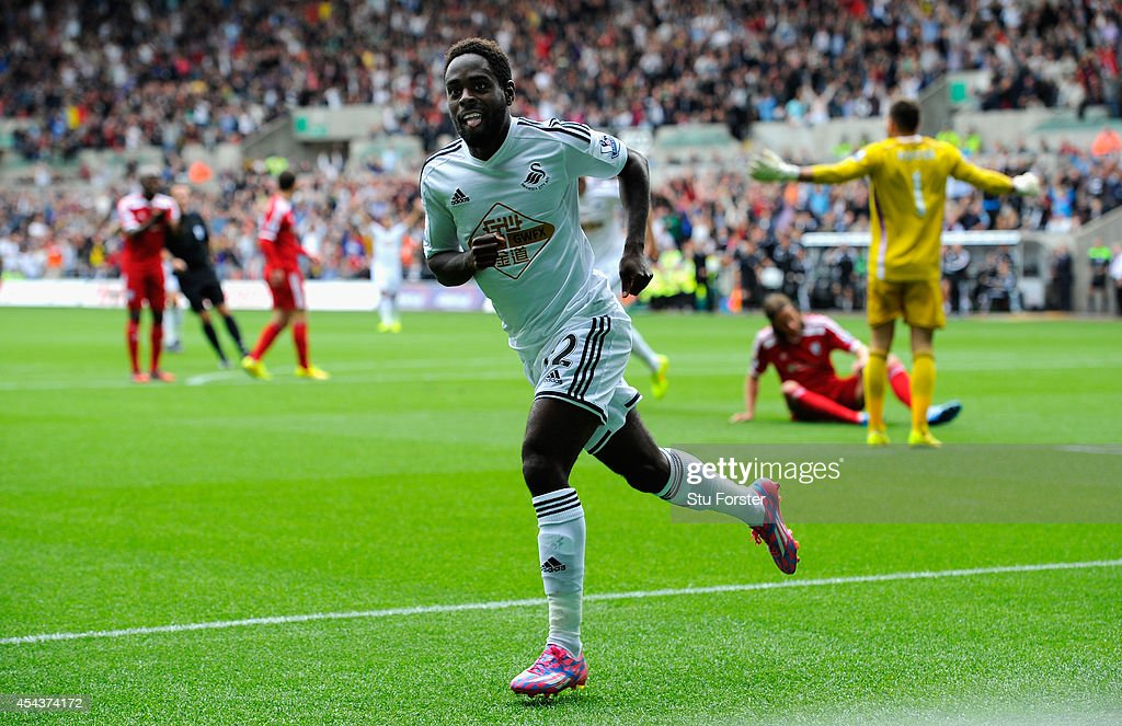 Swansea player Nathan Dyer celebrates after opening the scoring during the Barclays Premier League match between Swansea City and West Bromwich Albion at Liberty Stadium on August 30, 2014 in Swansea, Wales.