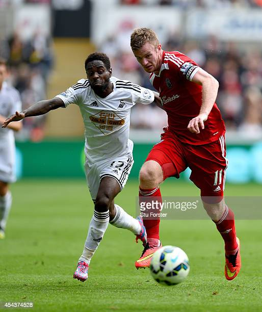 Swansea player Nathan Dyer challenges Chris Brunt of West Brom during the Barclays Premier League match between Swansea City and West Bromwich Albion...