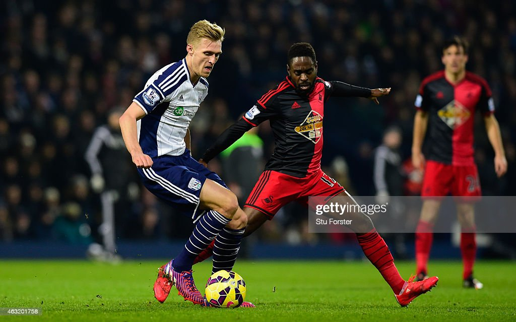 Swansea player Nathan Dyer (r) challenges Darren Fletcher of West Brom during the Barclays Premier League match between West Bromwich Albion and Swansea City at The Hawthorns on February 11, 2015 in West Bromwich, England.