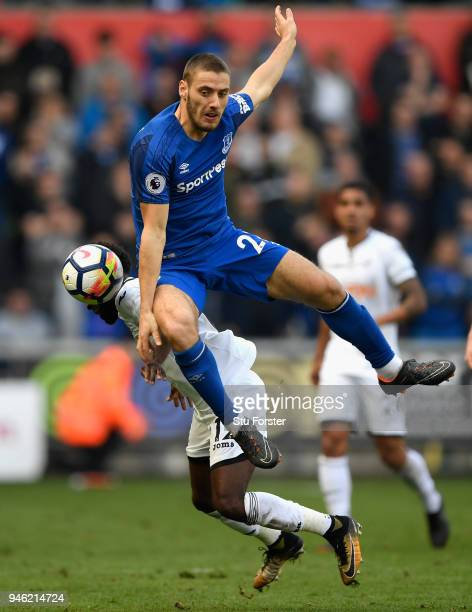 Swansea player Nathan Dyer is challenged by Nikola Vlasic of Everton during the Premier League match between Swansea City and Everton at Liberty...