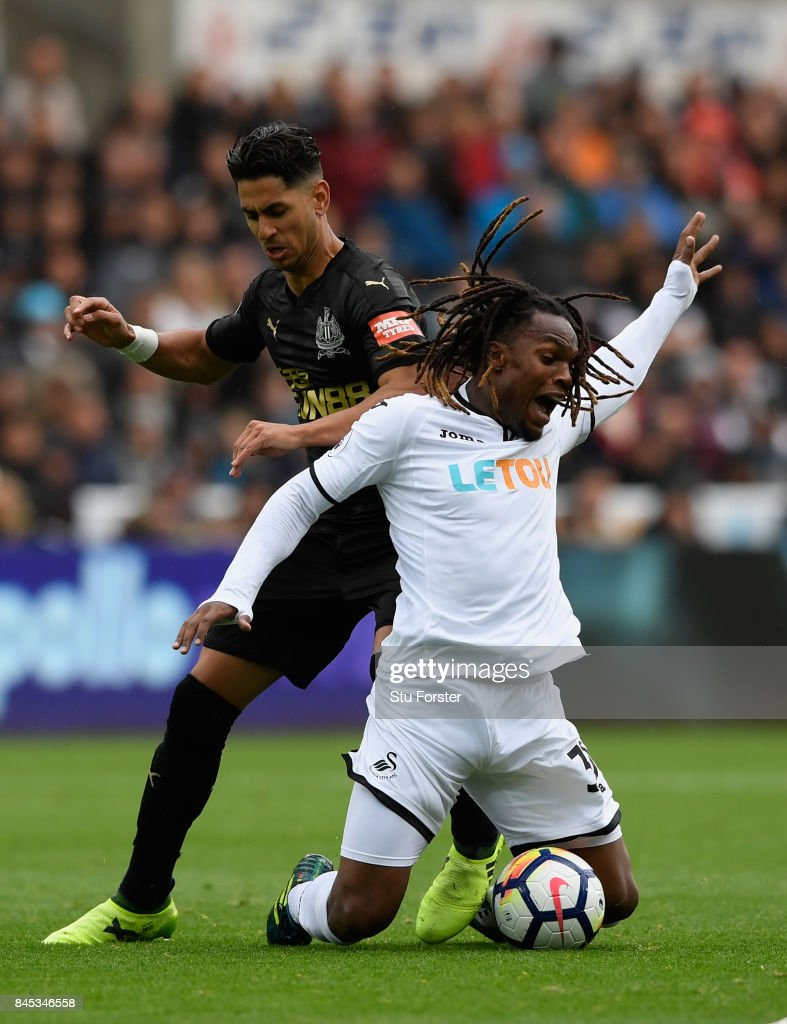 Swansea player Renato Sanches (r) is challenged by Ayoze Perez of Newcastle during the Premier League match between Swansea City and Newcastle United at Liberty Stadium on September 10, 2017 in Swansea, Wales.