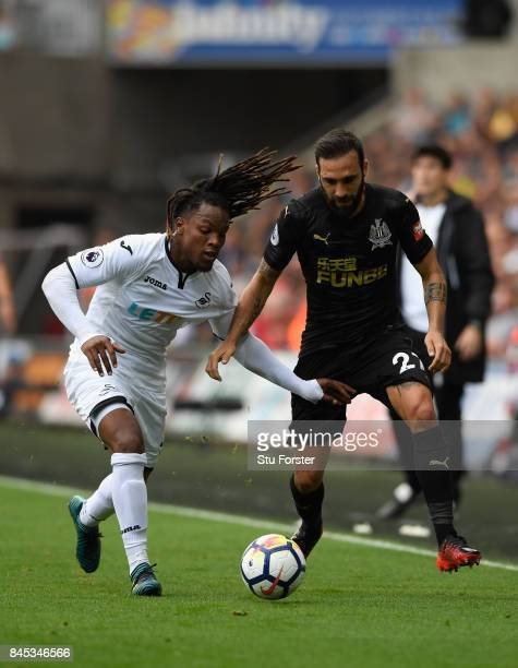 Swansea player Renato Sanches is challenged by Jesus Gamez of Newcastle during the Premier League match between Swansea City and Newcastle United at...