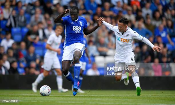Swansea player Roque Mesa challenges Cheikh Ndoye of Birmingham during the Pre Season Friendly match between Birmingham City and Swansea City at St...