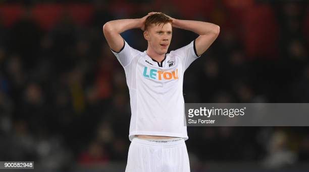 Swansea player Sam Clucas reacts after a chance goes begging during the Premier League match between Swansea City and Tottenham Hotspur at Liberty...