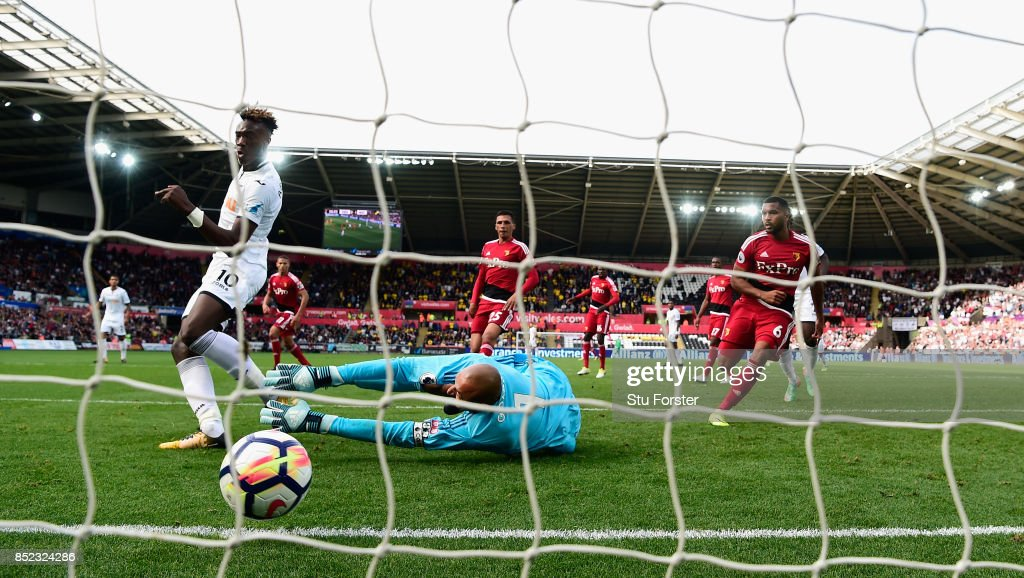 Swansea player Tammy Abraham scores for Swansea past Heurelho Gomes to equalise during the Premier League match between Swansea City and Watford at Liberty Stadium on September 23, 2017 in Swansea, Wales.