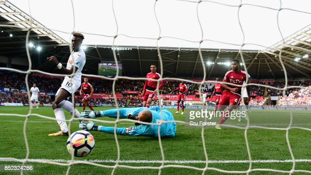 Swansea player Tammy Abraham scores for Swansea past Heurelho Gomes to equalise during the Premier League match between Swansea City and Watford at...