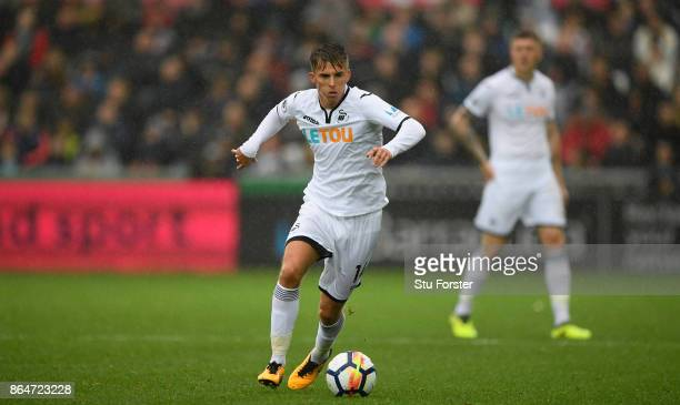 Swansea player Tom Carroll in action during the Premier League match between Swansea City and Leicester City at Liberty Stadium on October 21 2017 in...