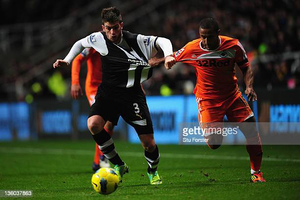 Swansea player Wayne Routledge is challenged by Davide Santon during the Barclays Premier league game between Newcastle United and Swansea City at St...