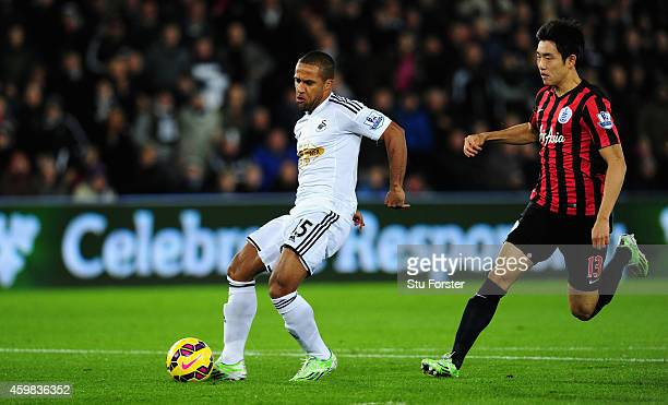 Swansea player Wayne Routledge shoots at goal during the Barclays Premier League match between Swansea City and Queens Park Rangers at Liberty...