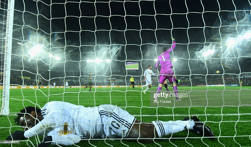 Swansea player Wilfried Bony ends up in the back of the net after a near miss during the Barclays Premier League match between Swansea City and Tottenham Hotspur at Liberty Stadium on December 14, 2014 in Swansea, Wales.