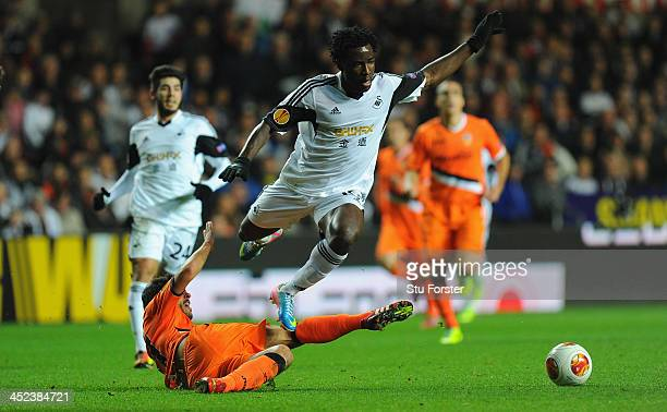 Swansea player Wilfried Bony is tackled by Daniel Parejo of Valencia during the UEFA Europa League group A match between Swansea City and Valencia CF...