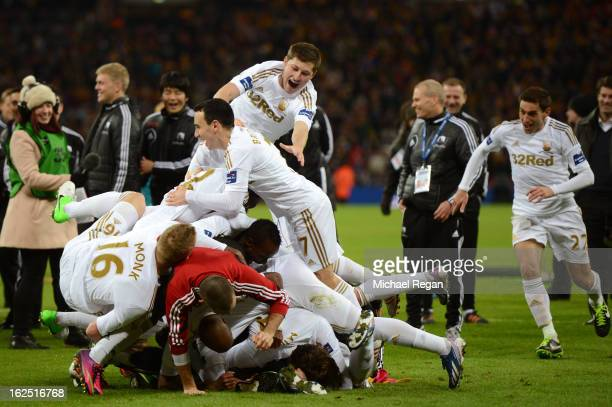 Swansea players celebrate their 50 victory during the Capital One Cup Final match between Bradford City and Swansea City at Wembley Stadium on...