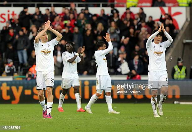 Swansea players Federico Fernandez and Ki Sung Yueng thank supporters at the end of the Barclays Premier League match between Swansea City and...