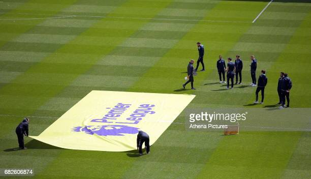 Swansea players inspect the pitch while the Premier League banner is laid on the ground prior to the Premier League match between Sunderland and...