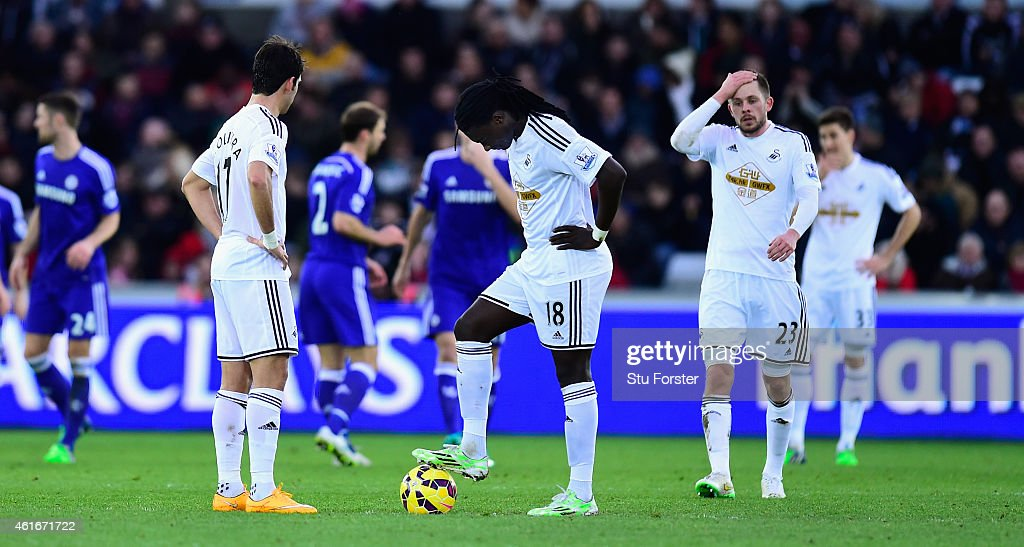 Swansea players react as they prepare to kick off after going 3-0 down during the Barclays Premier League match between Swansea City and Chelsea at Liberty Stadium on January 17, 2015 in Swansea, Wales.