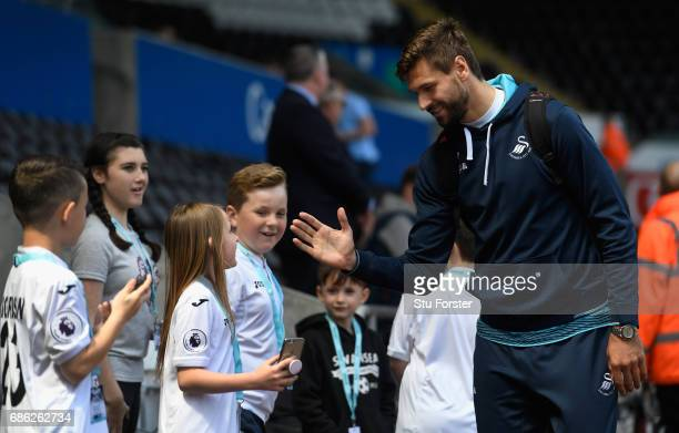 Swansea striker Fernando Llorente greets young fans before the Premier League match between Swansea City and West Bromwich Albion at Liberty Stadium...