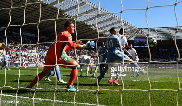 Swansea striker Fernando Llorente watches his header go past Stoke goalkeeper Jack Butland for the first goal during the Premier League match between...